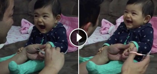 Adorable baby pretends to cry as dad cuts her fingernails