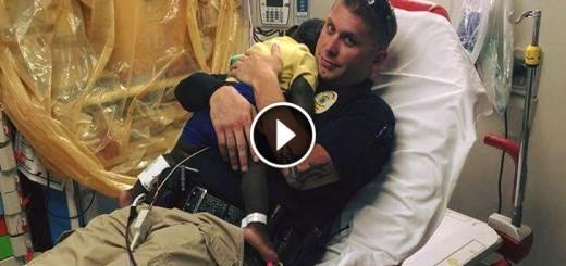 officer comforts boy hospital